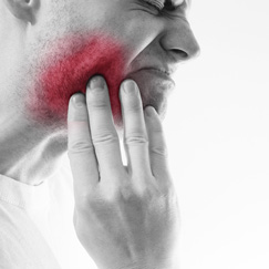 Pain or discomfort in the mouth