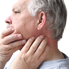 Difficulty or pain with swallowing, chewing or moving the jaw
